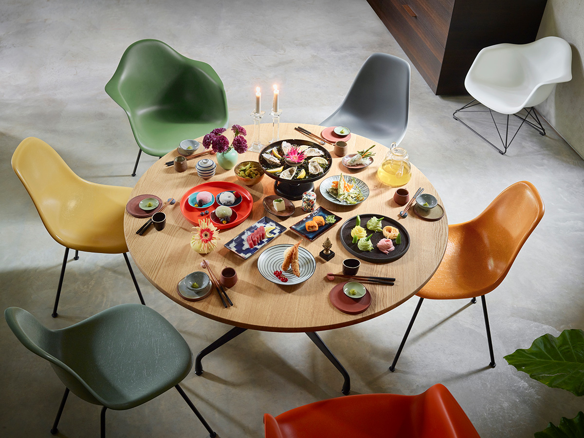 Colourful Eames Fiberglass Shell Chairs around a dining table