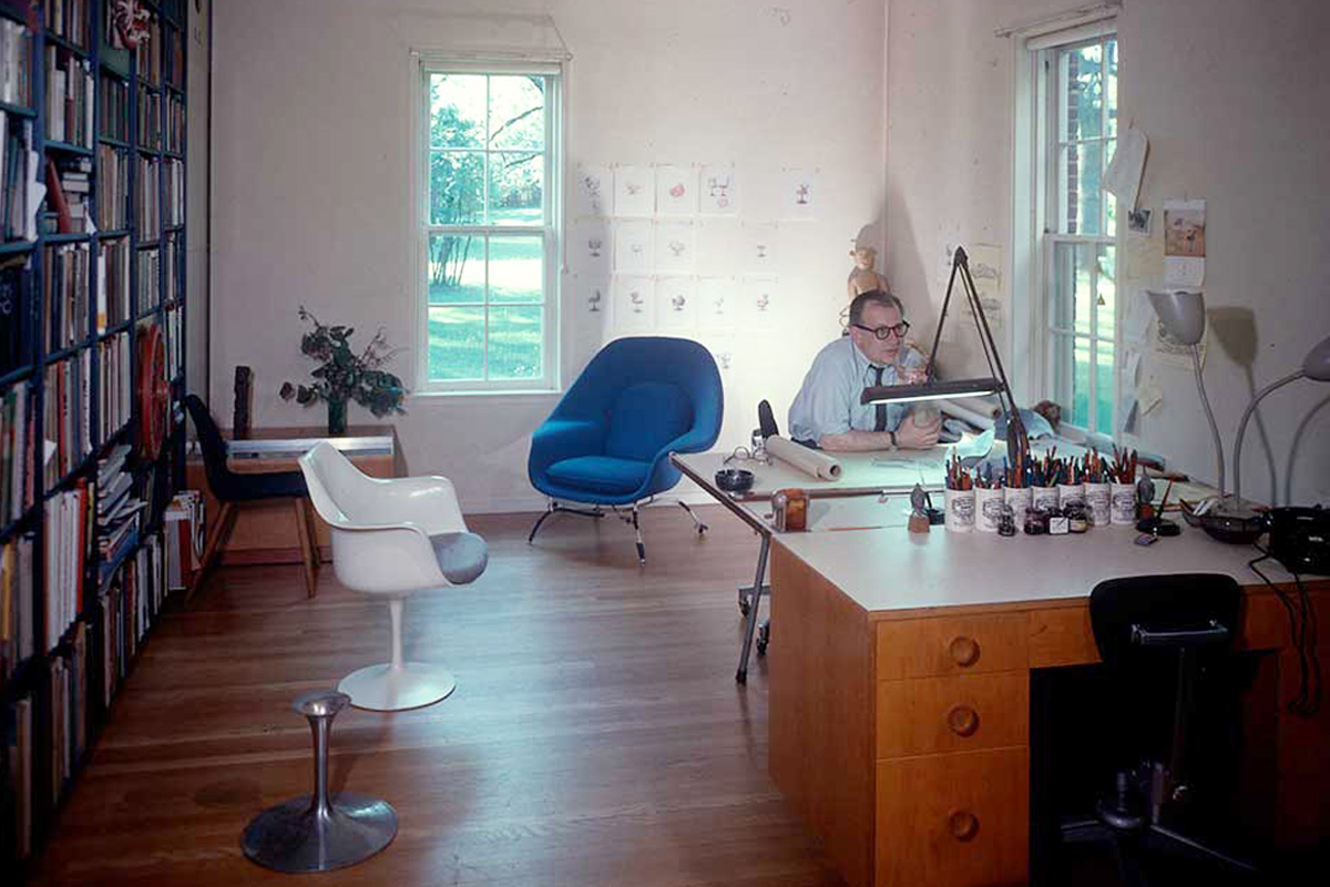 Eero Saarinen working in his studio with the Tulip Chair and Womb Chair