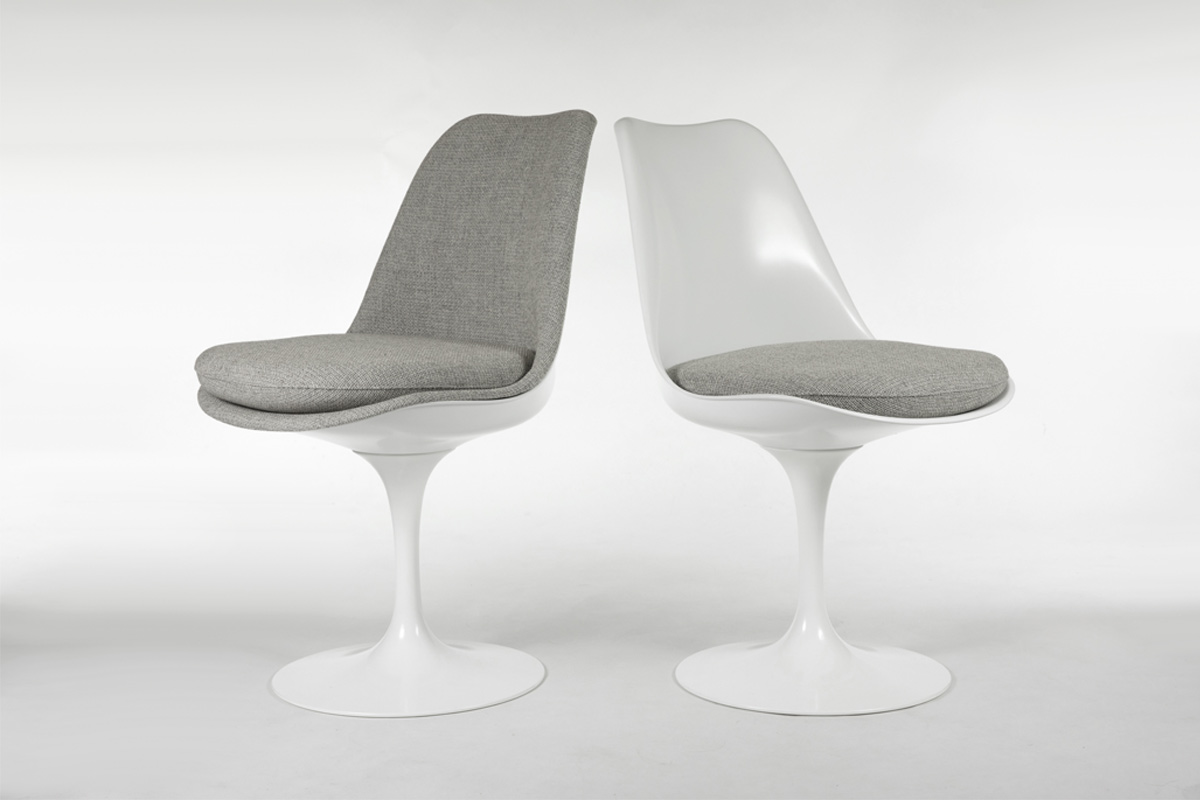 The Tulip Chair is available with a cushioned base and a fully upholstered shell