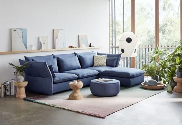 Blue Vitra Mariposa Sofa in a modern living room