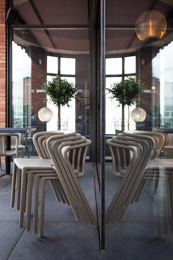 Stack of Magis Air Armchairs on the Bistrot Pierre terrace