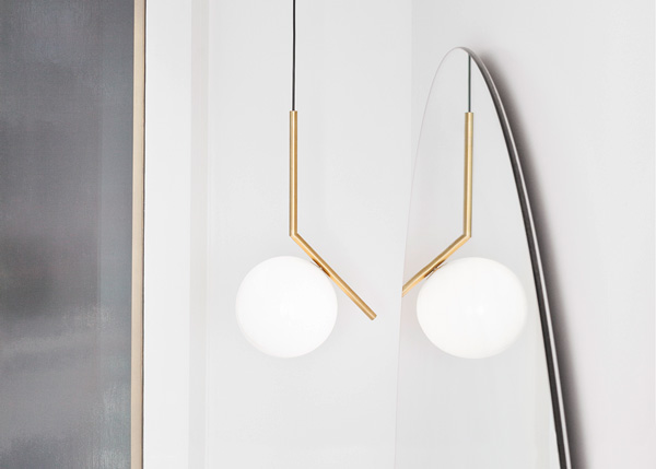 Brass Flos IC S2 Pendant in front of a mirror