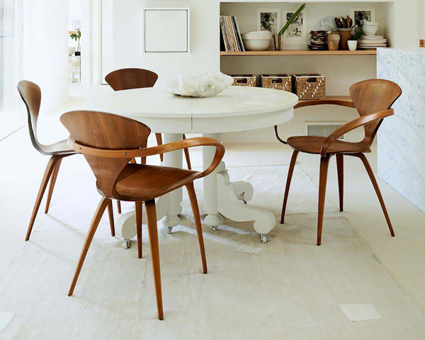 4 Cherner Armchairs around a white circular dining table