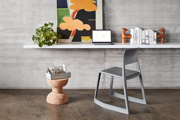 A Vitra Tip Ton RE Chair being used a desk chair in a minimal, modern office