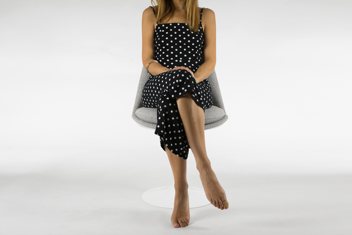 Woman sitting on Knoll Tulip Chair