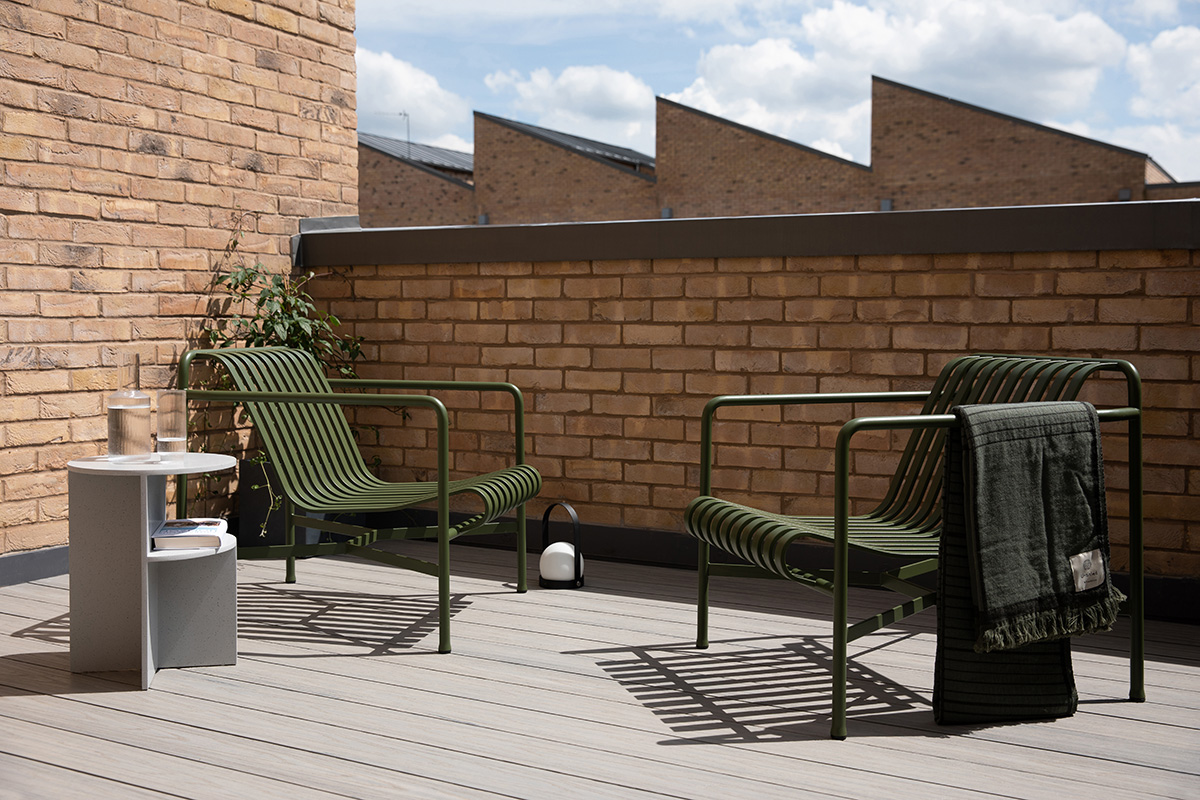 2 HAY Palissade Lounge Chairs on an urban roof terrace in the sunshine