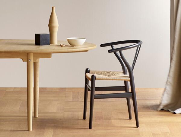 Grey Carl Hansen CH24 Wishbone Chair at a dining table
