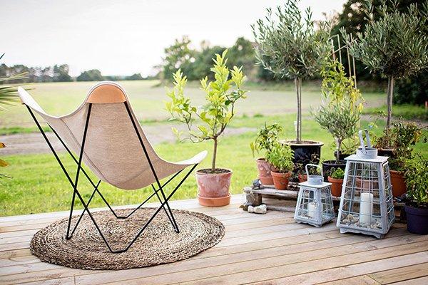Cuero Design hemp canvas butterfly chair canvas mariposa on a deck outdoors