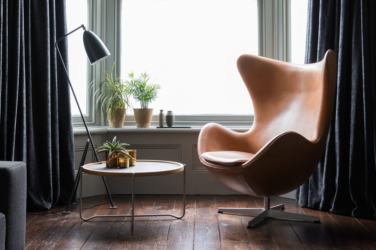 Leather Fritz Hansen Egg Chair in front of a window