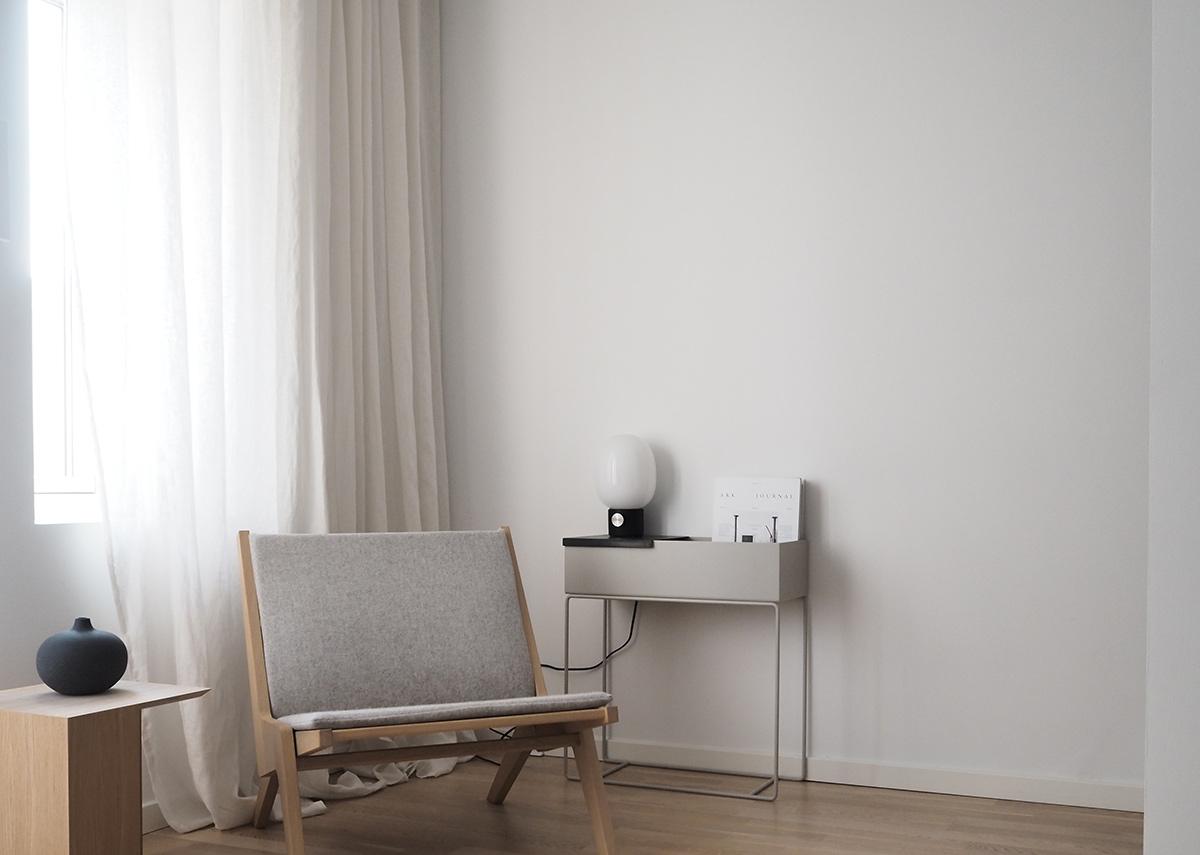 Living room featuring: Skagerak Building Table, Ferm Living Plant Box, Menu JWDA Table Lamp