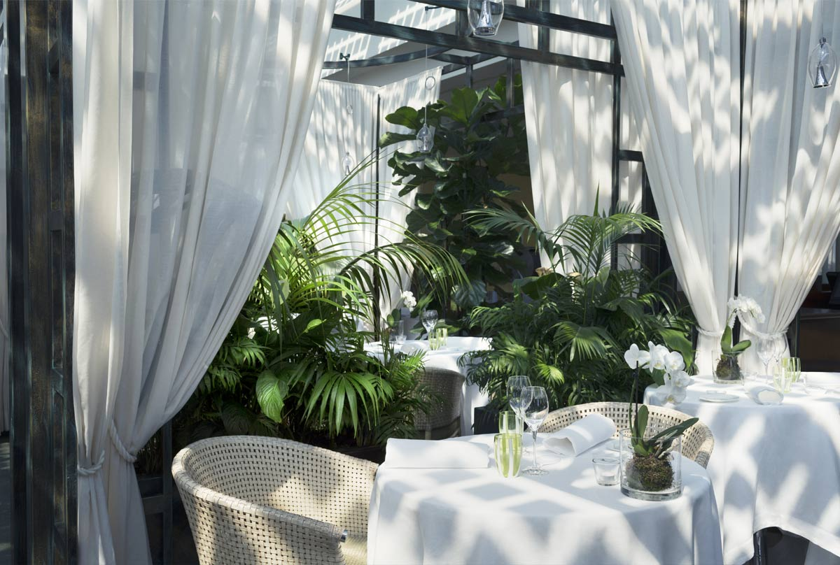 Outdoor dining with cool cottons and lush plants. At the Lefay Resort & Spa.jpg