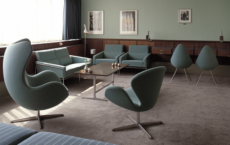 Room 606 in the SAS Royal Hotel in Copenhagen — furnished with the Egg and the Swan Lounge Chairs. Building and furniture by Arne Jacobsen 1956-1958.