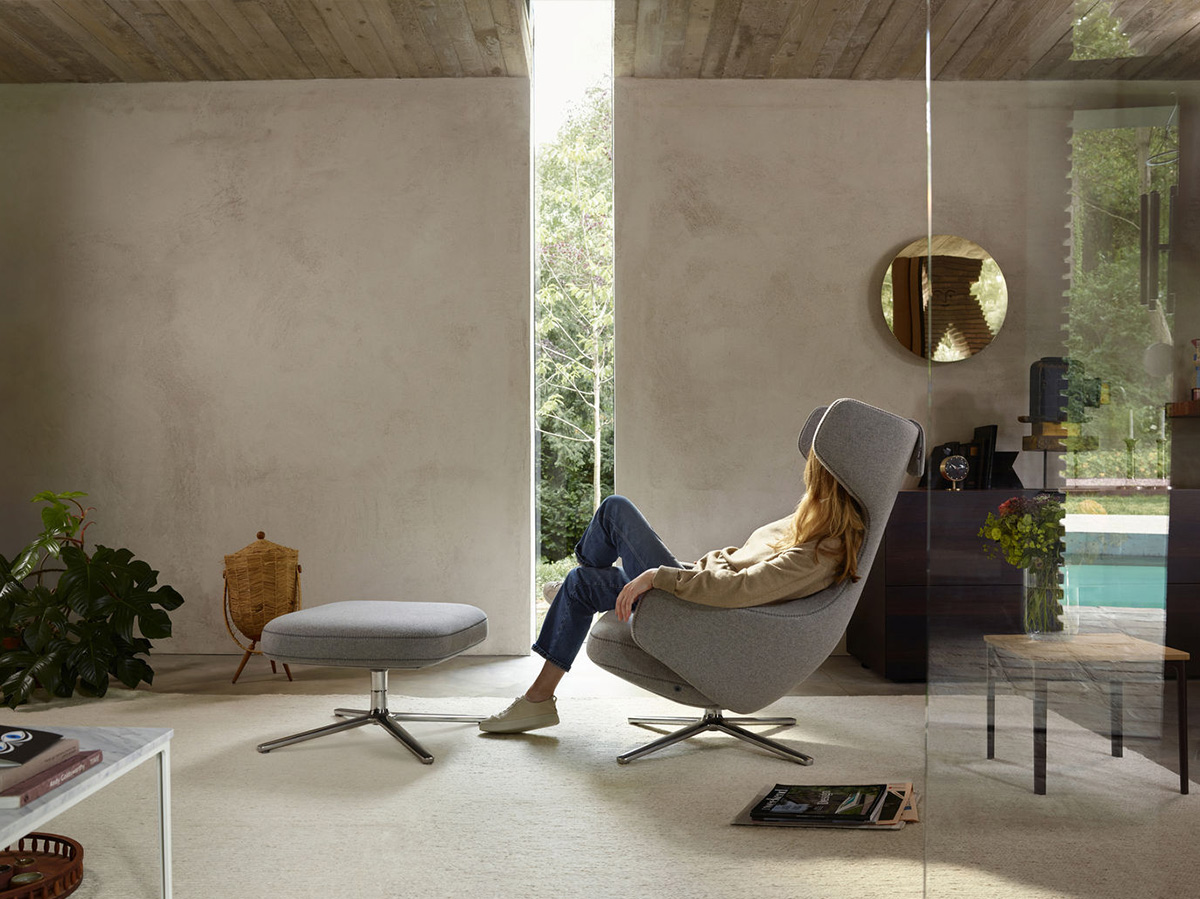 Woman relaxing in the Vitra Grand Repos Lounge Chair
