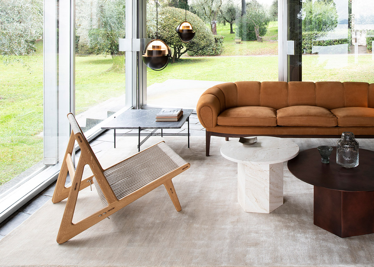 Gubi MR01 Initial Chair inside a modern house next to Gubi Epic Tables and Multi-Lite pendant