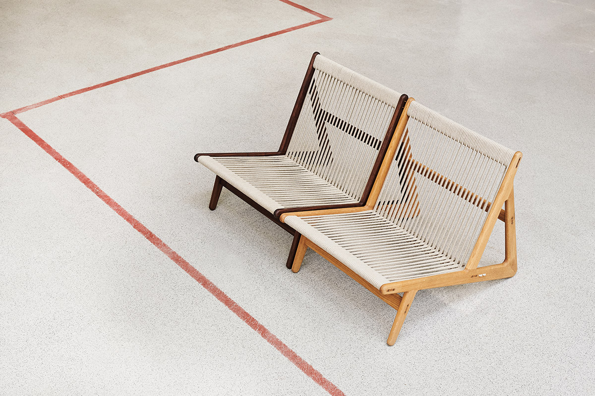 2 GUBI Initial Chairs next to each other on a concrete floor