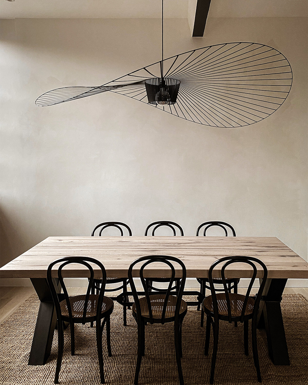 Petite Friture Vertigo Pendant Light above a neutral dining table