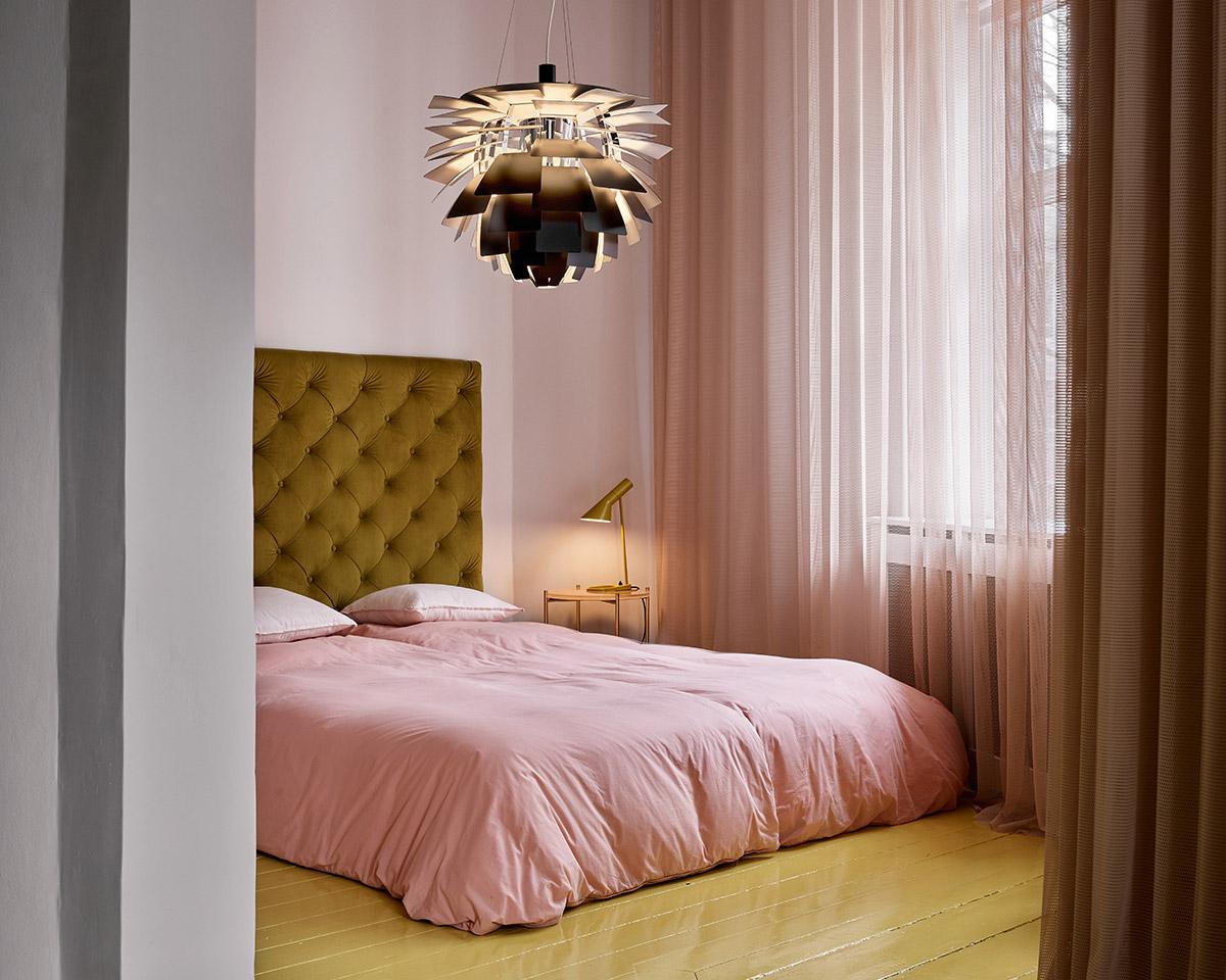 Louis Poulsen Artichoke Pendant and AJ Table Lamp in a pink bedroom