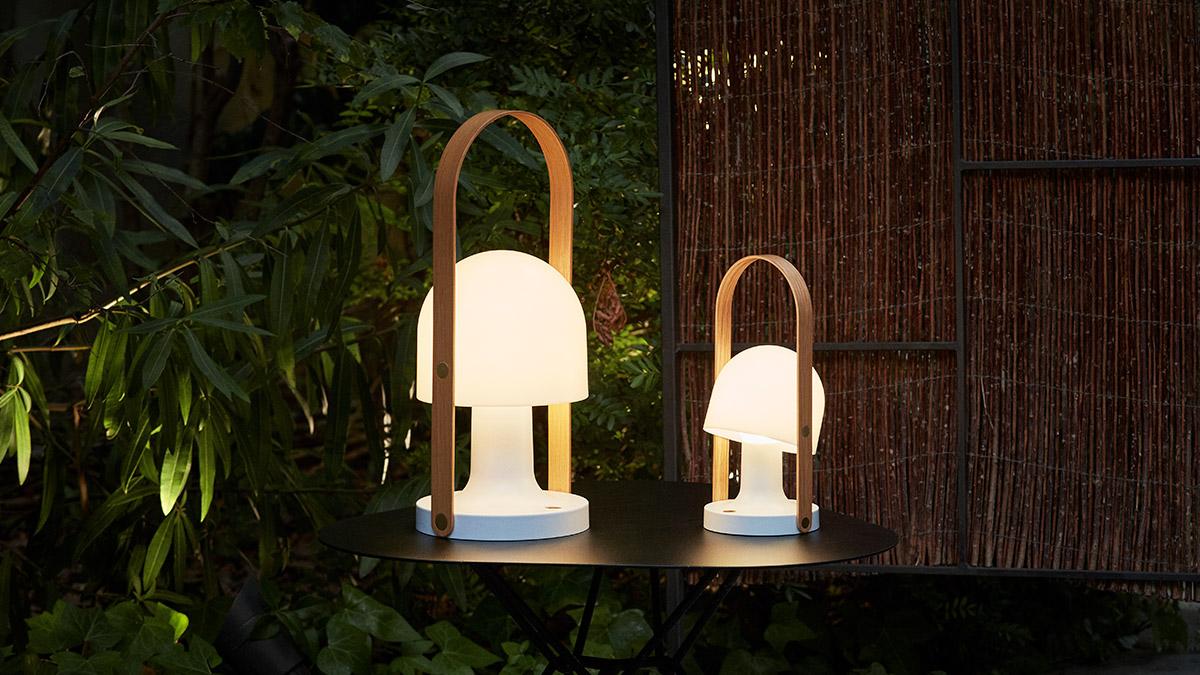 Marset FollowMe and FollowMe Plus portable table lamps on a garden table