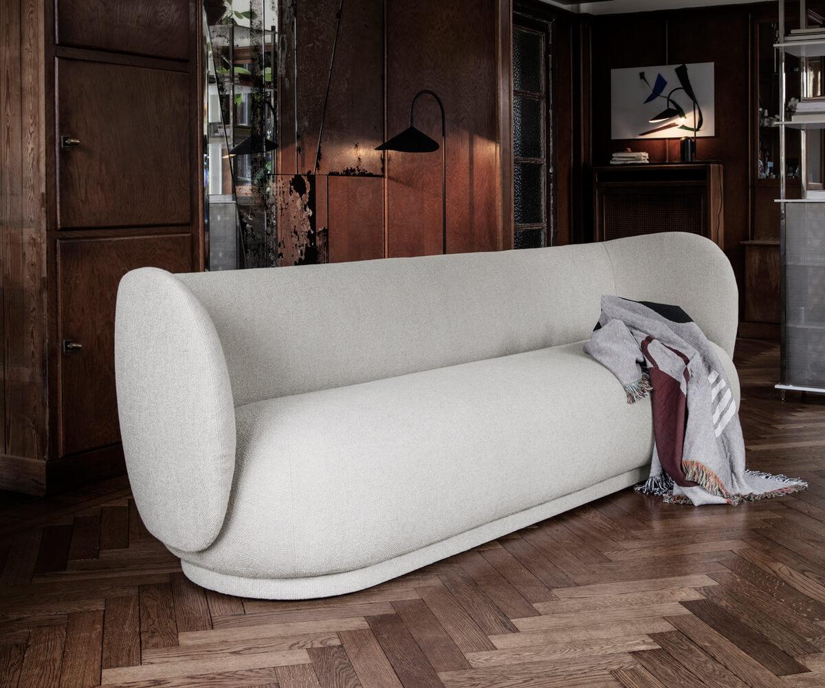 Off-white Ferm Living Rico Sofa in a dark wood interior