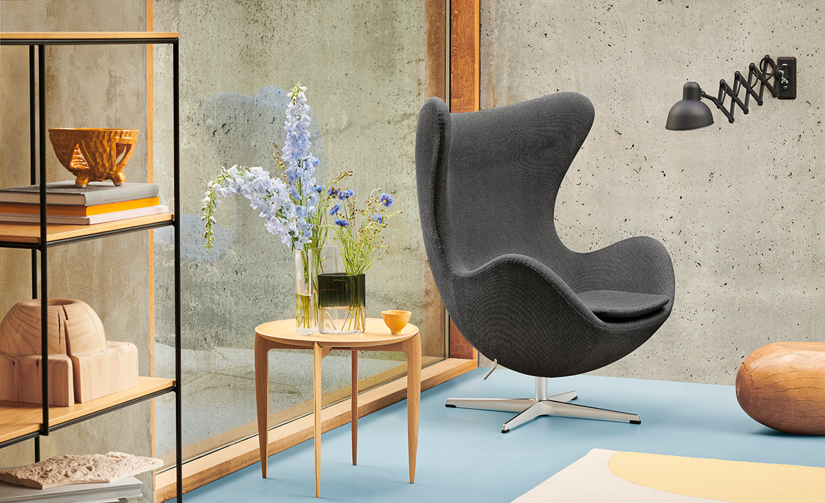 An Egg Chair and Foldable Tray Table from fritz Hansen inside a modern interior