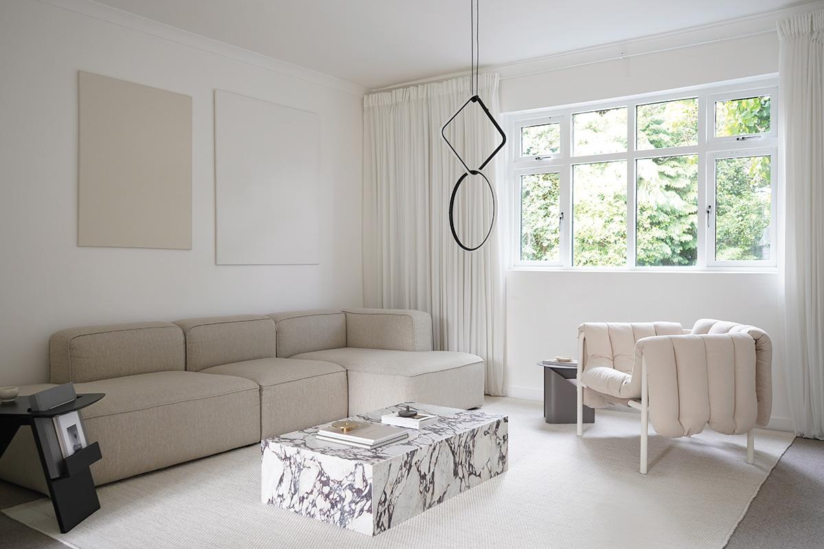 A minimal living room featuring the Menu Plinth