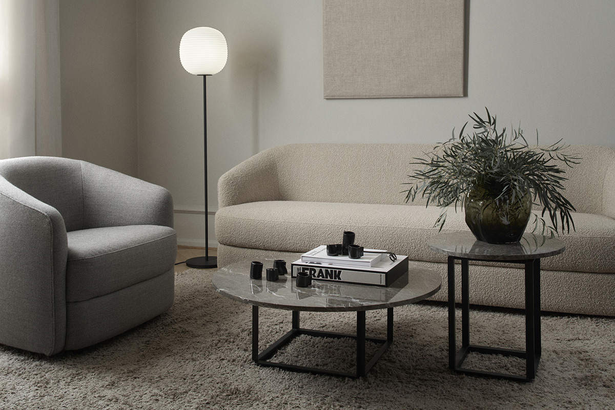The New Works Florence Coffee and Side Table in front of a neutral sofa