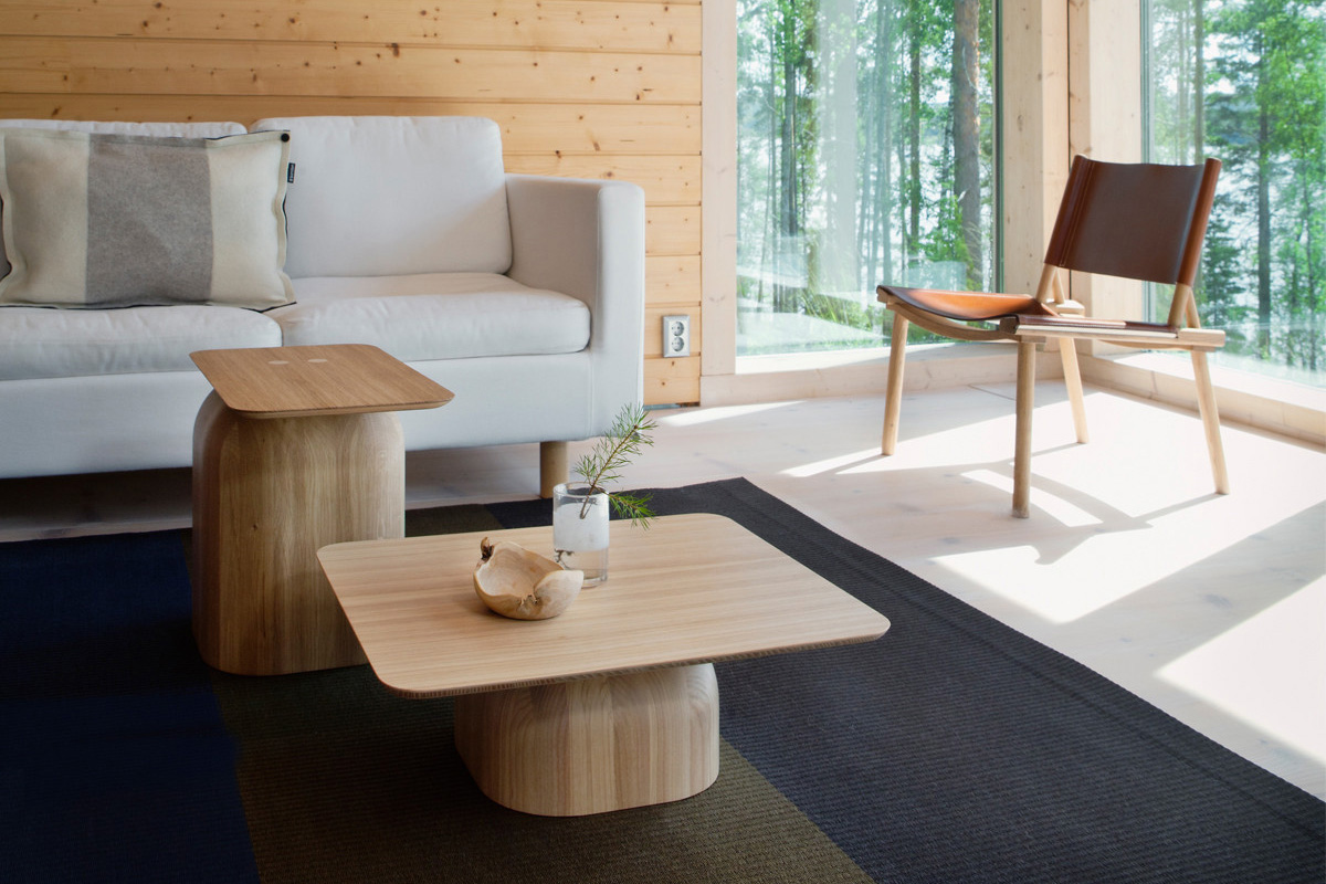 Two Nikari April Tables being used as coffee tables inside a modern wooden lodge
