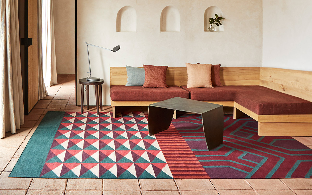 The GAN Kilim Ndebele Rug with a wooden sofa and coffee table