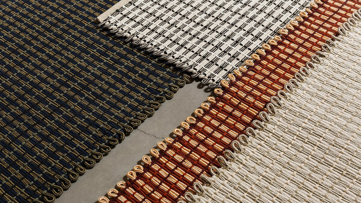 A close up image of four hem rope rugs overlapping