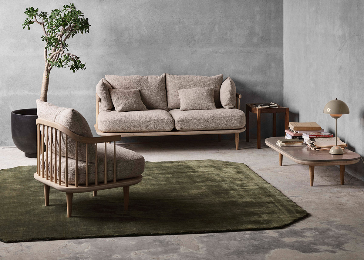 &Tradition The Moor rug in green pine underneath the &Tradition Fly Sofa