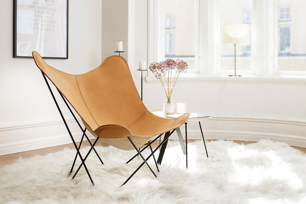Lifestyle image of the Cuero Design Butterfly Lounge Chair in Crude Nature leather
