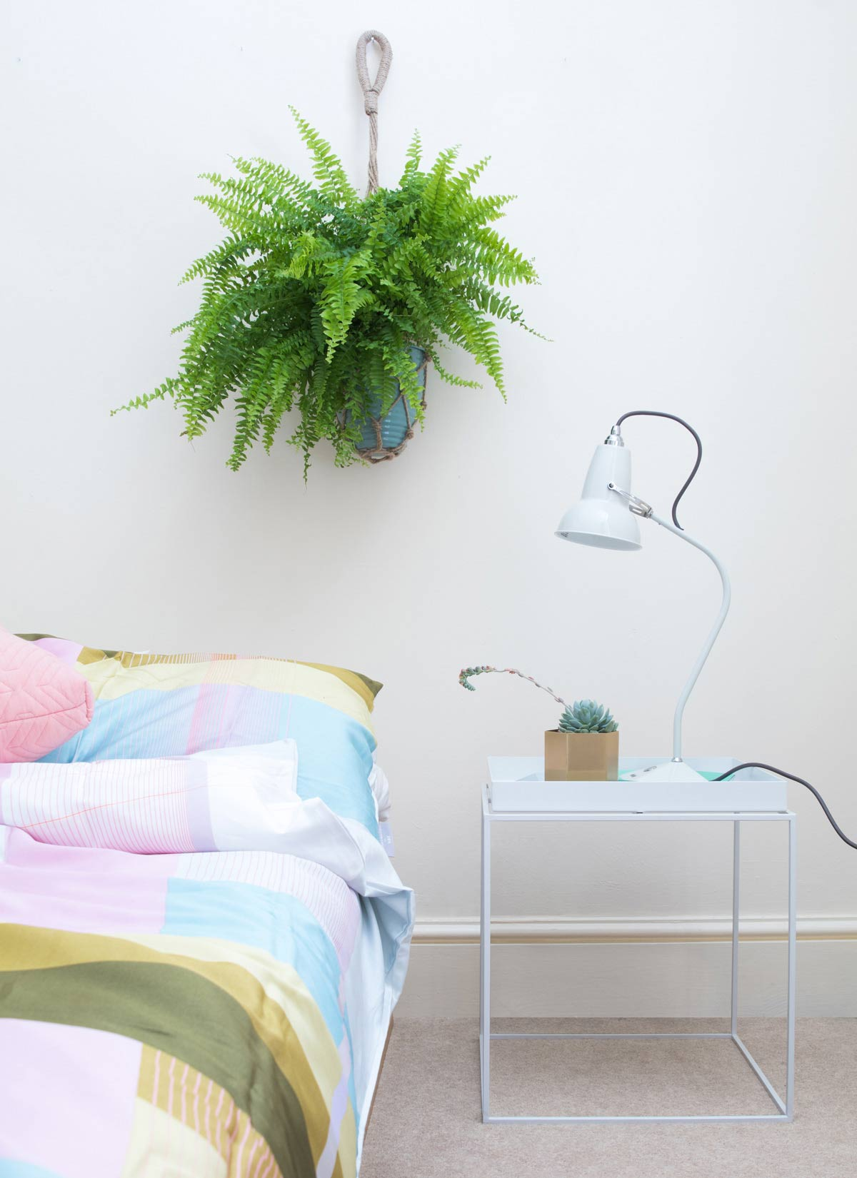 Bedroom scene featuring HAY Tray Table, Ferm Living Hexagon Pot and Anglepoise Original 1227 Mini Ceramic Table Lamp .jpg