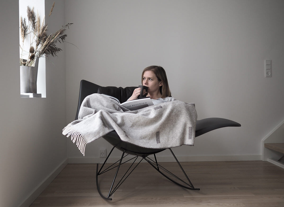Interior Stylist Hannah Tricket in the Stingray Rocking Chair by Fredericia