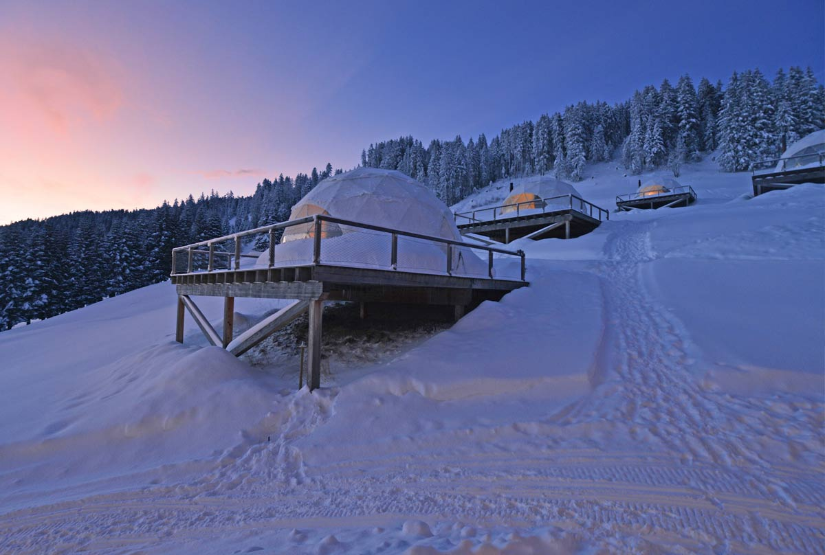 The dome shaped tents at White Pod, Switzerland.jpg