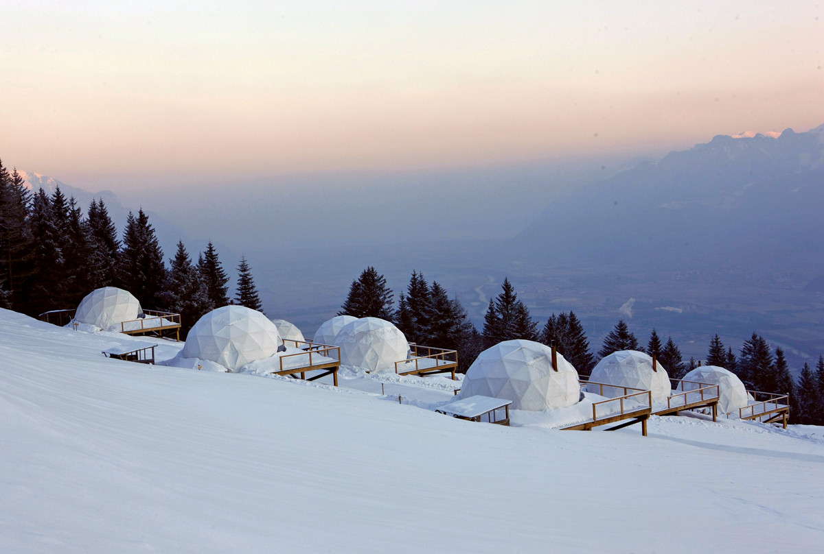 Exterior of the dome shaped tents at White Pod, Switzerland.jpg