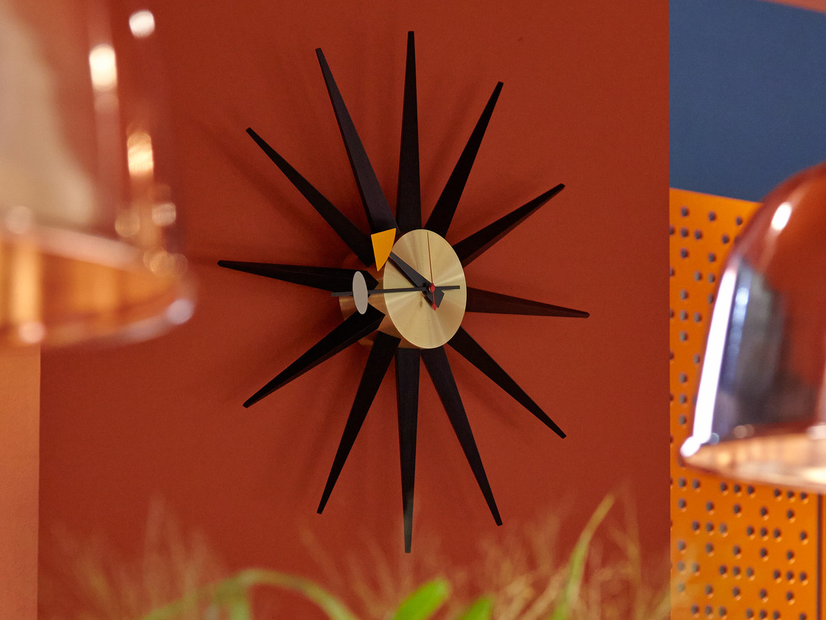 buy the vitra sunburst wall clock at. Black Bedroom Furniture Sets. Home Design Ideas