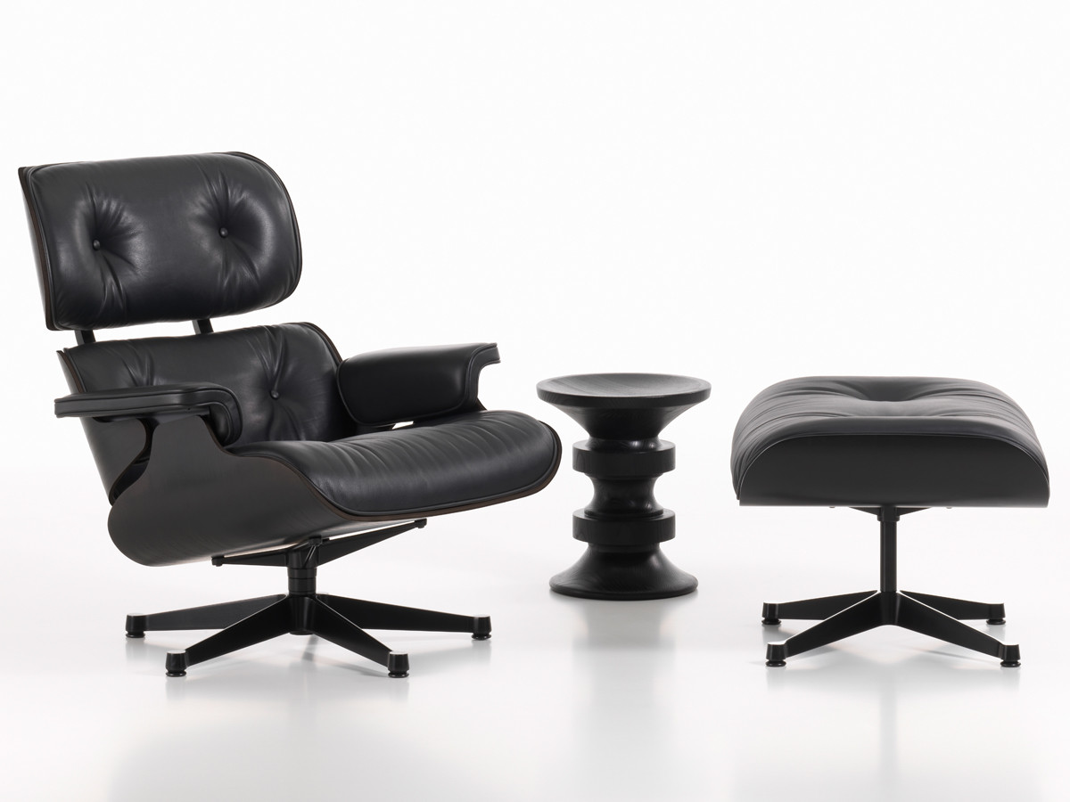Buy the vitra eames lounge chair ottoman all black at for Eames vitra replica